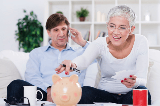 Woman budgeting for dental implants